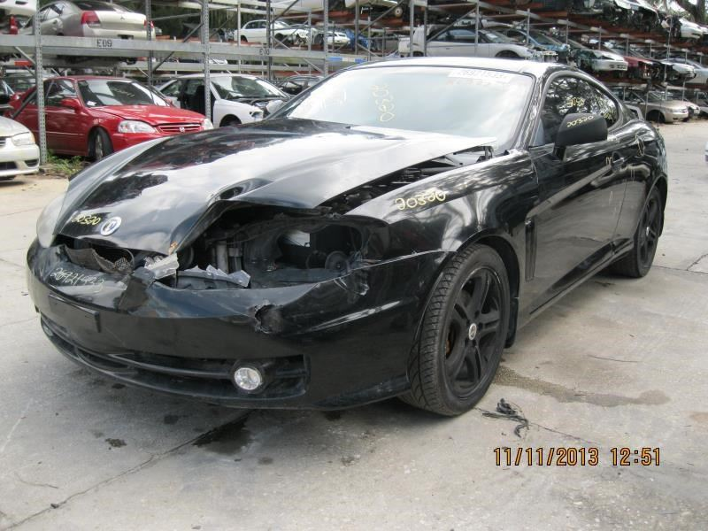 2003 hyundai tiburon electrical tiburon tail lamp |  166 BLK,2DR,WALKIN,STRESS CRACKS