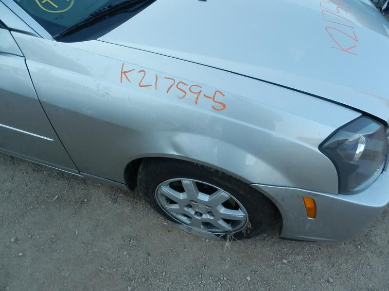 2003 cadillac cts suspension-steering cts spindle knuckle  front |  515 SIL-994L,RWD,12/04,OIC