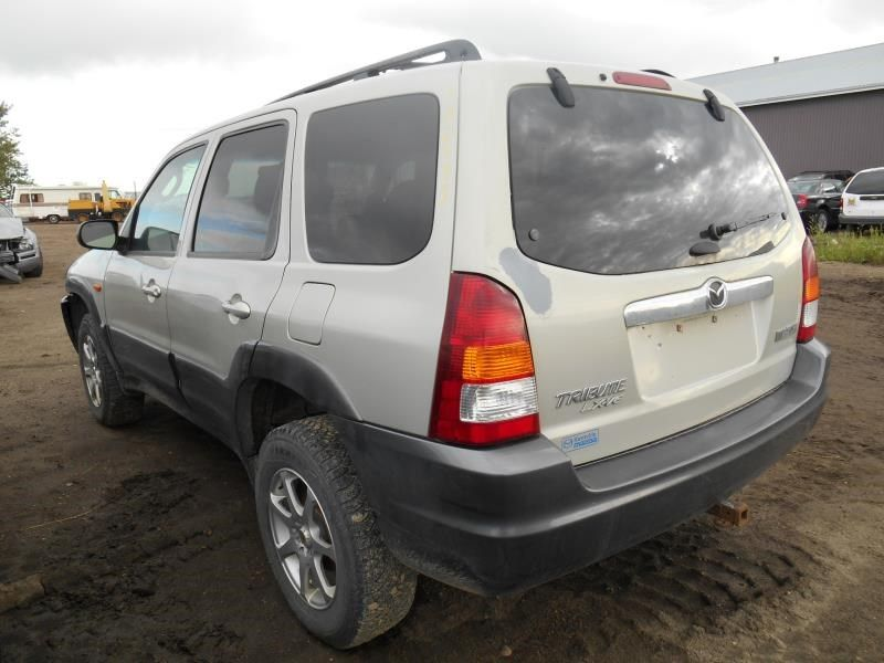 2001 mazda mazda-tribute rear-body mazda tribute bumper assembly rear 190 SMOOTH WITH HITCH,2 INCH CRACK RT