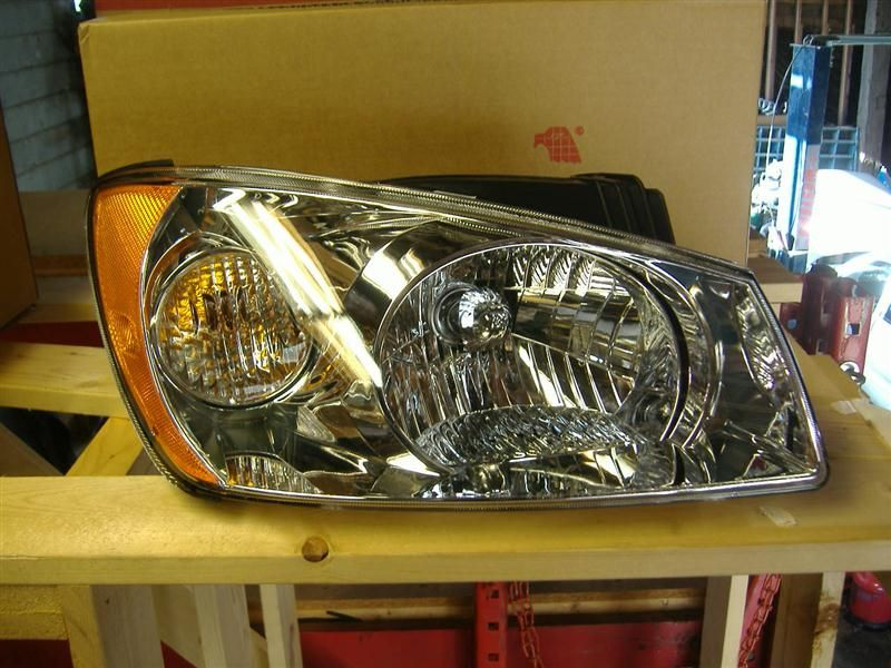 2006 kia spectra5 lights headlamp assembly right sdn  4 dr   ex  r  |  114 NEW AFT