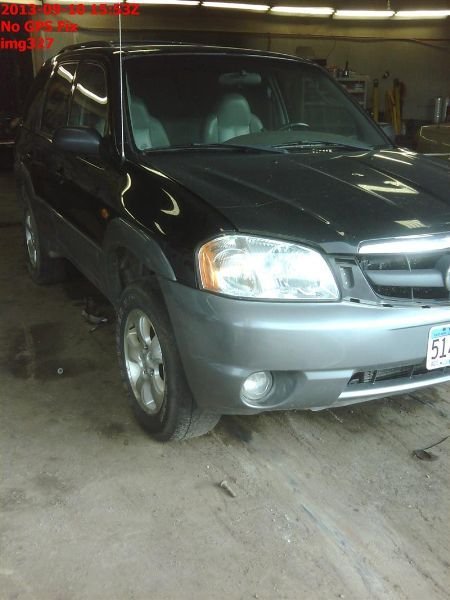 2001 mazda mazda-tribute rear-body mazda tribute bumper assembly  rear |  190 NIQ,GRY,3D2,DENT LH,PIN HOLE,SCUFFS